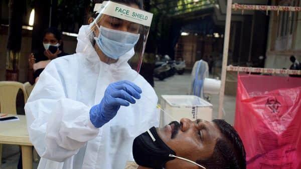 BMC Medical staff conducting Antigen test for COVID-19 in Jian health center Dadar, in Mumbai on Saturday. (ANI Photo)