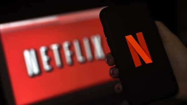 Netflix will notch up average revenue per user or ARPU of $5. (Photo by Olivier DOULIERY / AFP) (AFP)