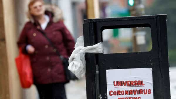 A poster reading 'Universal Coronavirus Testing Now' is seen on a bin in Liverpool, Britain (Reuters)
