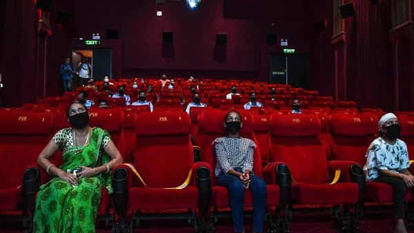 The government has allowed reopening of cinemas at 50% capacity. (Photo by Prakash SINGH / AFP)
