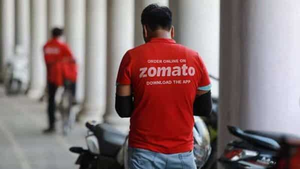 A delivery worker of Zomato, an Indian food-delivery startup, waits to collect an order from a restaurant. (Reuters)