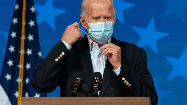 Democratic presidential candidate former Vice President Joe Biden removes his face mask to speak at The Queen theater, Thursday, Nov. 5, 2020, in Wilmington, Del. (AP Photo/Carolyn Kaster) (AP)