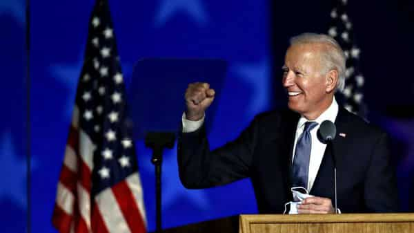 Joe Biden, 2020 Democratic presidential nominee, gestures while arriving during an election night party in Wilmington, Delaware, U.S., on Wednesday, Nov. 4, 2020. Donald Trump falsely declared early Wednesday he had won re-election against Biden and said he would ask the Supreme Court to intervene, even as several battleground states continue to count votes. Photographer: Stefani Reynolds/Bloomberg (Bloomberg)
