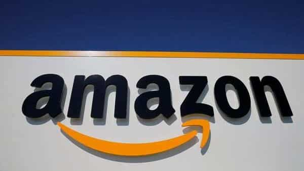 FILE PHOTO: The logo of Amazon is seen at a logistics centre (REUTERS)