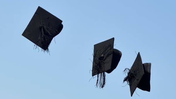 FILE PHOTO: 'Mortar board' hats are thrown in the air following a graduation ceremony for students at University of Brighton (REUTERS)