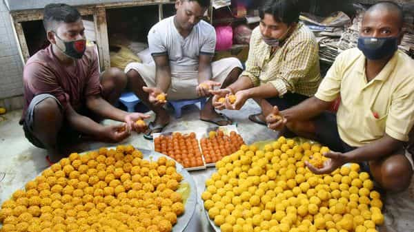 Workers prepare sweets for distribution, ahead of the counting for Bihar Assembly Elections, in Patna on Monday. (ANI Photo)
