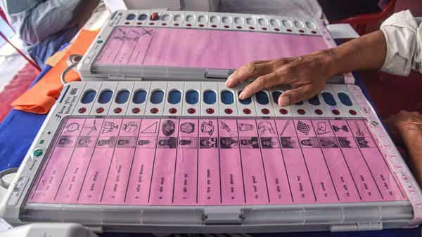 Electronic Voting Machine (EVM) sealing officers check EVMs. (PTI)