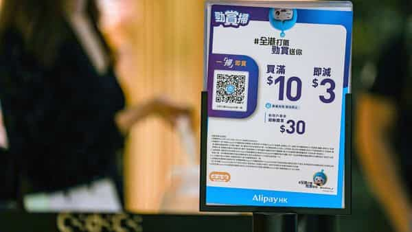 Signage for Ant Group Co.'s Alipay digital payment service at a store in Hong Kong, China, on Wednesday, Nov. 4, 2020. Hong Kong stocks swung between gains and losses after Chinese regulators scrapped Ant Group Co.'s $35 billion initial public offering, and as investors digested early results in the U.S. election. Photographer: Lam Yik/Bloomberg (Bloomberg)