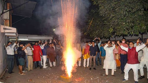 Patna: BJP workers celebrate after NDA's lead in the Bihar Assembly elections results, in Patna (PTI)
