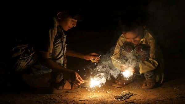 Children light firecrackers during Diwali in Mumbai (Reuters)
