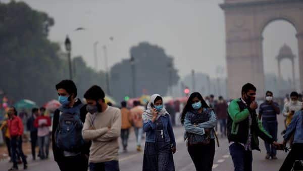 New Delhi: People walk in the rain near India Gate, in New Delhi, Sunday, Nov. 15, 2020.  (PTI)