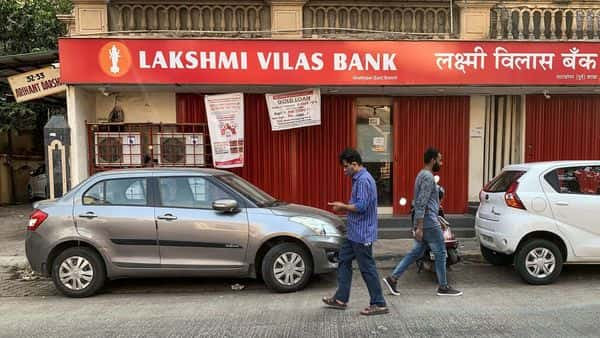 People walk past a Lakshmi Vilas Bank branch in Mumbai. (REUTERS)