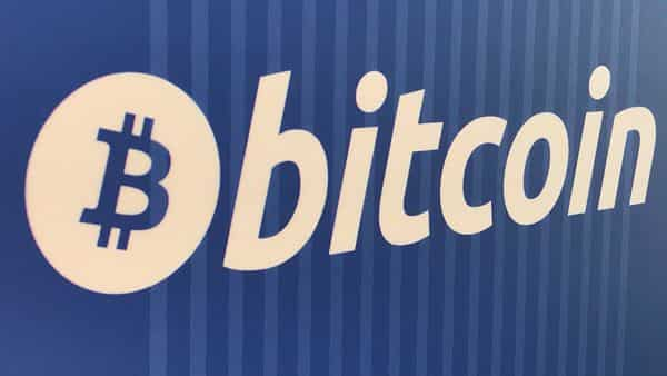 Bitcoin is nearing record highs after more than doubling this year, partly driven by fears that major central bank easing and fiscal stimulus will debase currencies. (REUTERS)