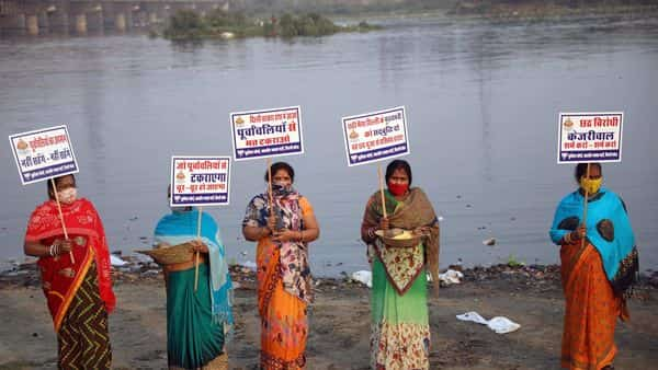 Delhi Bharatiya Janata Party Purvanchal Morcha workers hold placards as they protest against the ban on Chhath Puja by the Delhi Government. (ANI)
