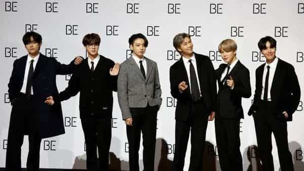 Members of BTS pose for photographs during a news conference promoting their new album 'BE(Deluxe Edition)' in Seoul (REUTERS)