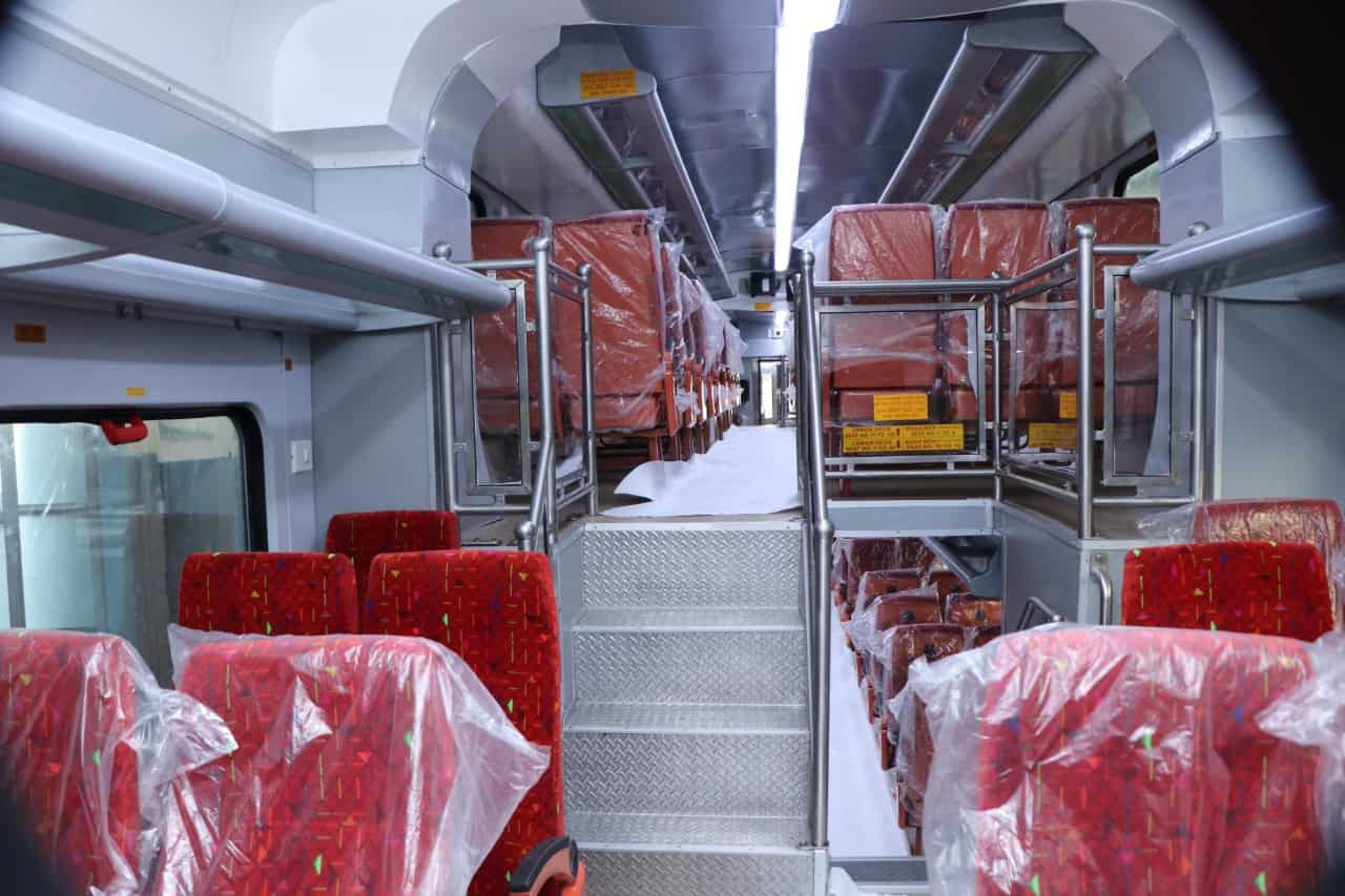 The middle deck on the rear ends has 16 seats on one side and six on the other. The coach has optimised aisle width for a comfortable journey, plush interiors, overhead luggage rack, mobile and laptop charging sockets, GPS-based passenger information system and LED destination board among other passenger-centric features. (Twitter)