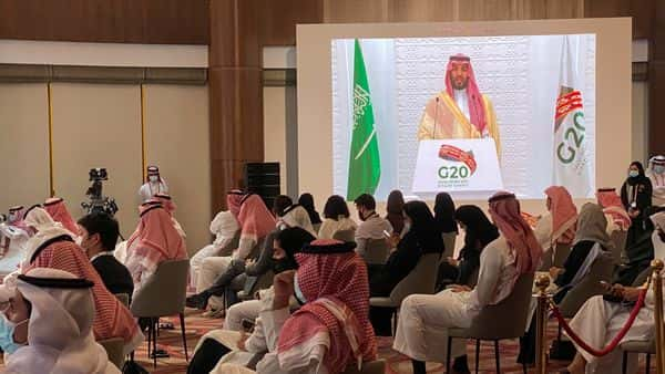 Saudi Crown Prince Mohammed bin Salman's virtual speech is aired live at the media centre of the 15th annual G20 Leaders' Summit in Riyadh (REUTERS)