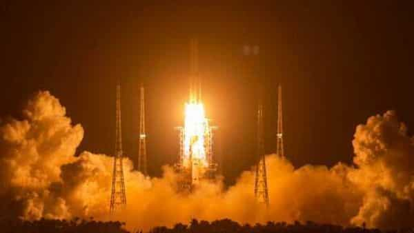A Long March-5 rocket carrying the Chang'e 5 lunar mission lifts off at the Wenchang Space Launch Center  (AP)