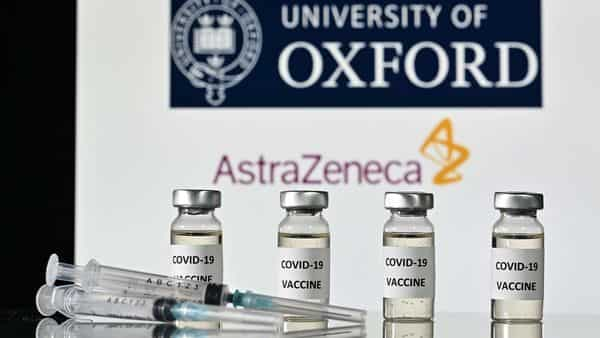 An illustration picture shows vials with Covid-19 Vaccine stickers attached and syringes, with the logo of the University of Oxford and its partner British pharmaceutical company AstraZeneca. (AFP)