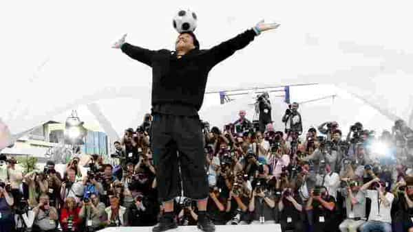 Stunned football fans were plunged into grief Wednesday by the death of the legendary footballer Diego Maradona, a sublimely gifted sporting hero they saw as 'the most human of Gods.' (REUTERS)