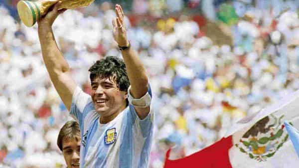 Diego Maradona with the World Cup trophy in 1986 after Argentina defeated West Germany in the final, (Photo: Getty Images)
