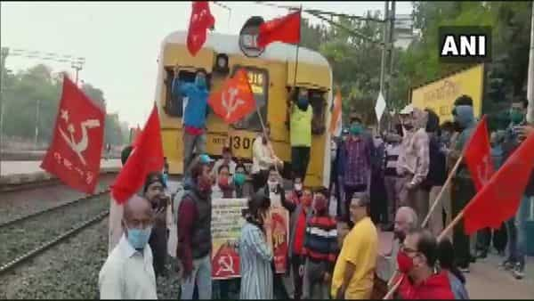 West Bengal: The members of Left trade union block railway track at Belgharia station in North 24 Parganas