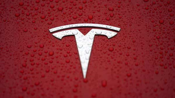 FILE PHOTO: A Tesla logo is seen at a groundbreaking ceremony of Tesla Shanghai Gigafactory in Shanghai, China  (REUTERS)