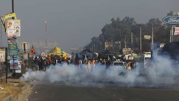 Tear gas is released to stop farmers opposing the farm law from entering Delhi at Singhu border. (REUTERS)