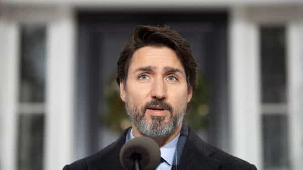 Canadian Prime Minister Justin Trudeau speaks at a bi-weekly news conference outside Rideau cottage on the COVID-19 pandemic in Ottawa, Ontario, Friday, Nov. 27, 2020. (Adrian Wyld/The Canadian Press via AP) (AP)