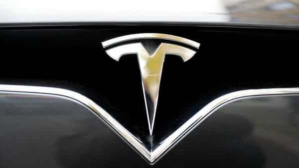 FILE PHOTO: The company logo is pictured on a Tesla Model X electric car in Berlin, Germany (REUTERS)
