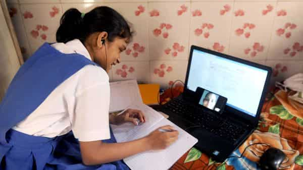 File Photo: A girl starts learning from online classes for students through a WhatsApp group, in Mumbai on Friday. (ANI Photo)