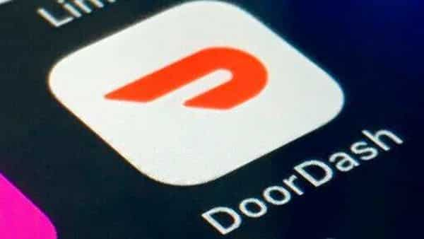 FILE - The DoorDash app is shown on a smartphone on Thursday, Feb. 27, 2020 in New York.  DoorDash Inc. is planning to sell its stock to the public, capitalizing on the growing trend of consumers embracing app-based deliveries as much of the world stays home during the pandemic. The company filed papers signaling its intent for initial public offering Friday, Nov. 13.  (AP Photo) (AP)