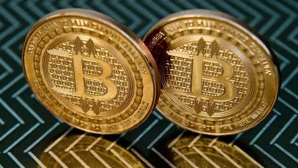 Experts expect the number of retail investors to grow even faster now that Bitcoin, by far the best known digital currency, has hit a lifetime high. (AFP)