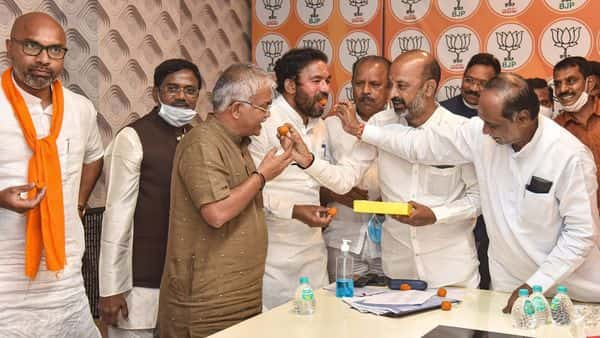Telangana State BJP President Bandi Sanjay Kumar, Union Minister of State for Home Affairs G Kishan Reddy along with other leaders celebrate the GHMC election results in Hyderabad, Friday (PTI)