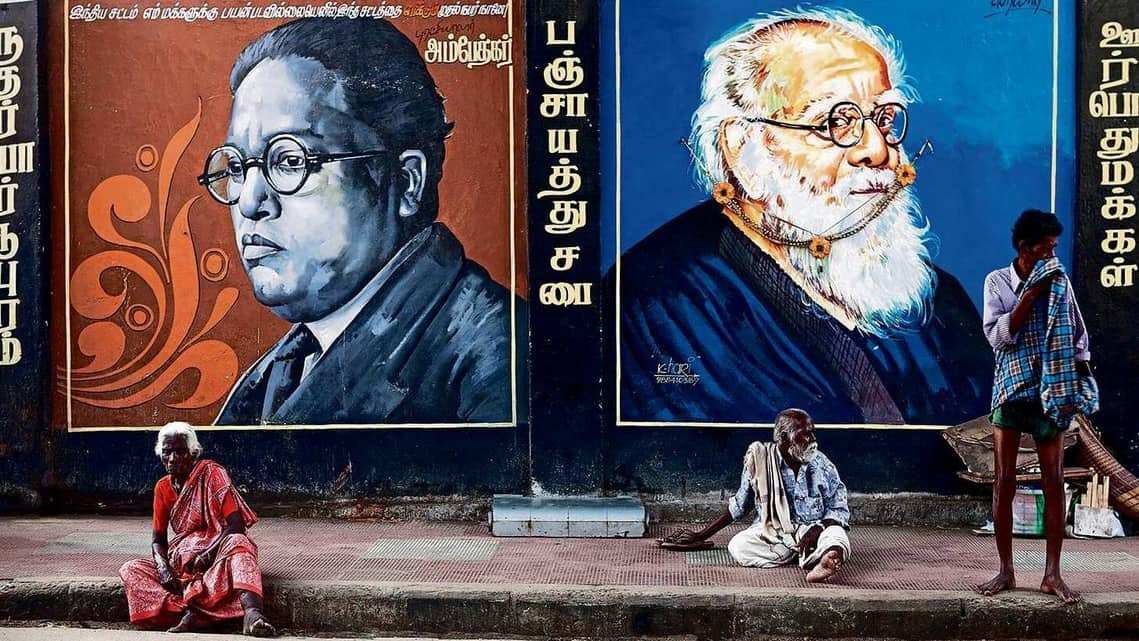Wall paintings of Babasaheb Ambedkar and Erode Venkata Ramasamy, both famous for their fight against discrimination. (Getty Images)