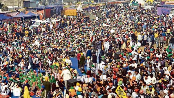 Farmers protest against the new farm laws at Singhu border, in New Delhi on Tuesday (MINT_PRINT)