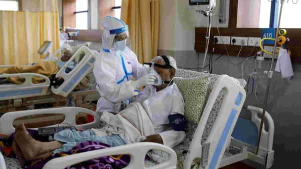 A medical worker takes care of a patient suffering from the coronavirus disease (Covid-19), at the Intensive Care Unit (ICU) of the Yatharth Hospital in Noida (REUTERS)