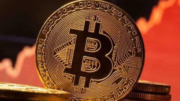 FILE PHOTO: A representation of virtual currency Bitcoin is seen in front of a stock graph in this illustration taken November 19, 2020. REUTERS/Dado Ruvic/Illustration (REUTERS)