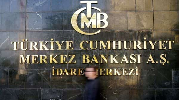 A man leaves Turkey's Central Bank headquarters in Ankara (REUTERS)