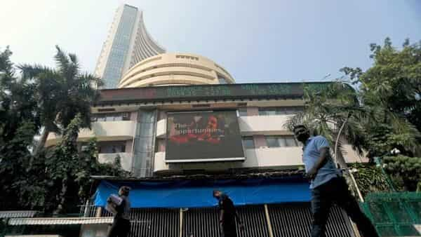 FILE PHOTO: People walk past the Bombay Stock Exchange (BSE) building in Mumbai. (REUTERS)