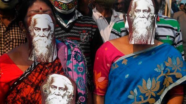 Activists of Trinamool Congress (TMC) wear pictures of Indian Nobel-laureate poet Rabindranath Tagore  (AFP)