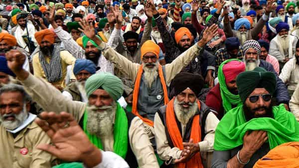 New Delhi: Farmers shout slogans at Singhu border during their 'Delhi Chalo' protest march against the Centre's new farm laws, in New Delhi,  (PTI)