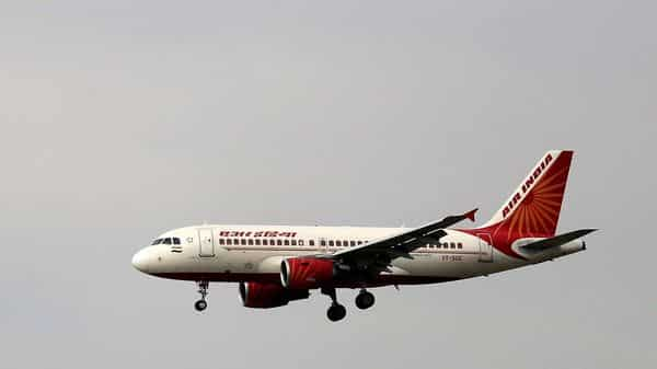 """FILE - In this April 16, 2015 file photo, an Airbus A319 of Air India prepares to land at the Indira Gandhi International airport in New Delhi, India. India's government says it has received """"multiple expressions of interest"""" in buying its 100% stake in the debt-laden national carrier Air India to shore up falling government revenues after an initial attempt in 2018 failed to attract any bidders. The deadline for submission of formal bids was Monday, Dec. 14, 2020, and the government is expected to announce the qualified bidders on Jan. 5. It did not reveal the identity of the bidders or the number of bids received. (AP Photo/Altaf Qadri, File) (AP)"""
