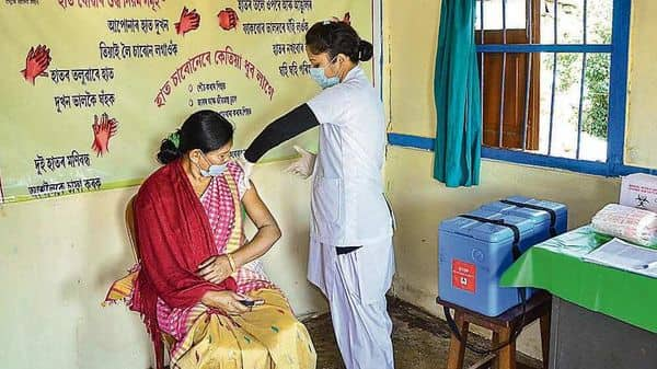 A medic demonstrates administration of Covaxin to a health worker during its trials in Assam's Tezpur  (PTI)
