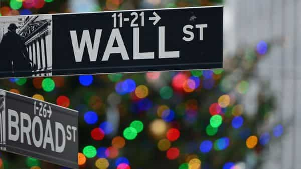 he Wall Street sign at the New York Stock Exchange (NYSE)  (AFP)