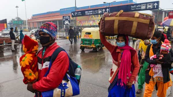 New Delhi: People arrive at New Delhi Railway Station during a cold winter morning after heavy rain, in New Delhi.  (PTI)
