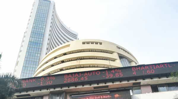 Mumbai: People walk in front of a digital screen at the facade of BSE, as the Sensex crossed 48000 mark for the first time, in Mumbai, Monday, Jan. 4, 2021. (PTI Photo/Shashank Parade) (PTI01_04_2021_000054A) (PTI)