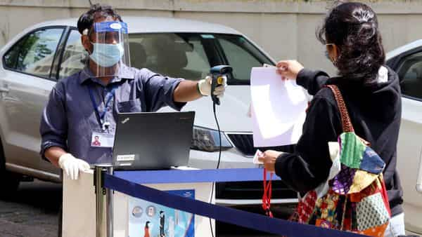 Student shows her admit card as she arrives to appear for the JEE exam at a school, after the COVID-19 lockdown in Panaji on Tuesday (ANI Photo)