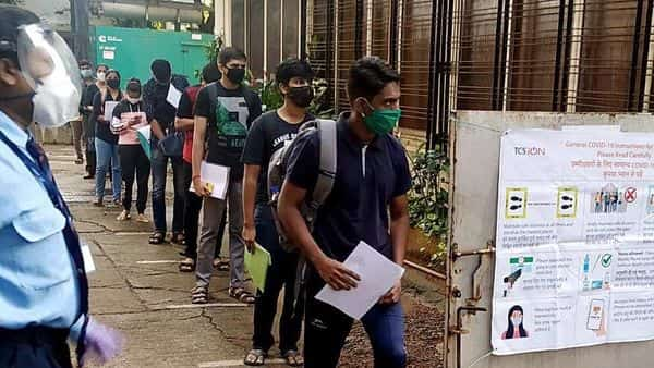 File photo: Students stand in a queue as they arrive to appear for the JEE exam. (ANI)