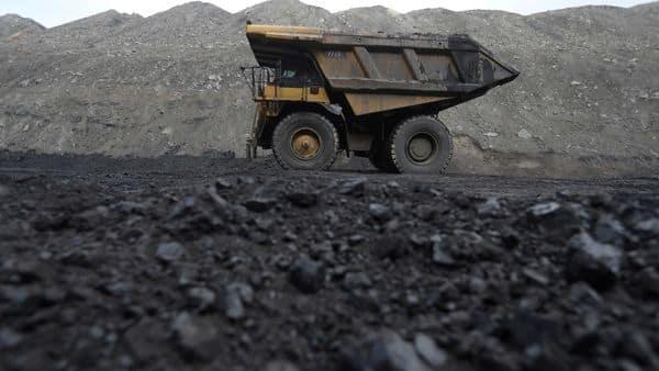 Dump trucks haul coal and sediment. (REUTERS)